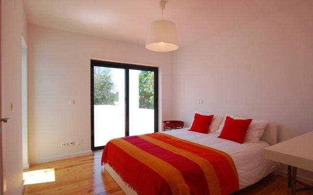 Отель Comporta Villas & Suites комната для гостей