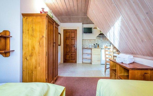 Отель Aparthotel Pod Nosalem Закопане комната для гостей