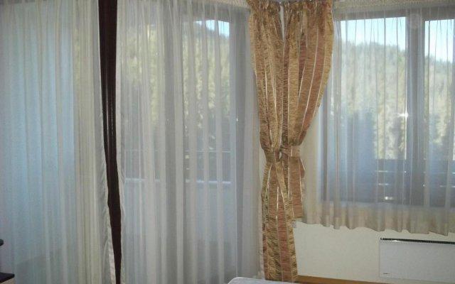 Апартаменты Gal Apartments In Pamporovo Elit Пампорово комната для гостей