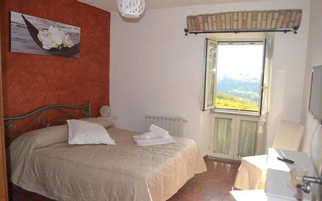 Отель Casale Colle dell' Asino комната для гостей