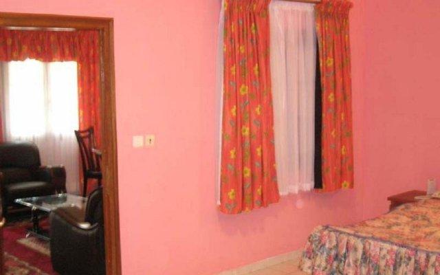 Отель Residence Saint-Jacques Bord de Mer Республика Конго, Пойнт-Нуар - отзывы, цены и фото номеров - забронировать отель Residence Saint-Jacques Bord de Mer онлайн комната для гостей