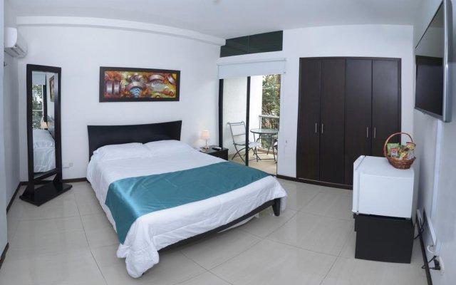 Отель Ofihotel Peñon Suites Колумбия, Кали - отзывы, цены и фото номеров - забронировать отель Ofihotel Peñon Suites онлайн комната для гостей