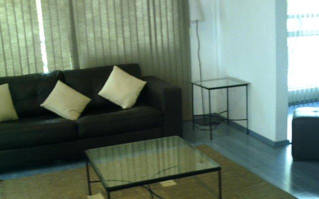 Отель Suites del Carmen - Churubusco Мексика, Мехико - отзывы, цены и фото номеров - забронировать отель Suites del Carmen - Churubusco онлайн комната для гостей