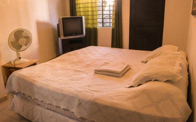 Отель Iguana Boutique Колумбия, Кали - отзывы, цены и фото номеров - забронировать отель Iguana Boutique онлайн комната для гостей