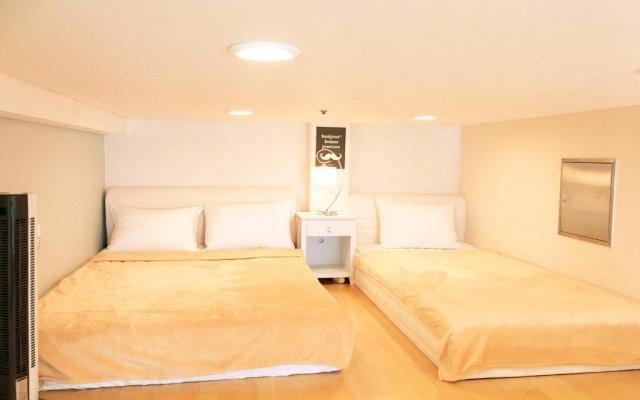Отель Family Loft-a Сеул комната для гостей