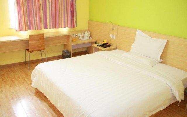 Отель 7Days Inn Chongqing Wanzhou District Gaosun Pond Chongbai комната для гостей