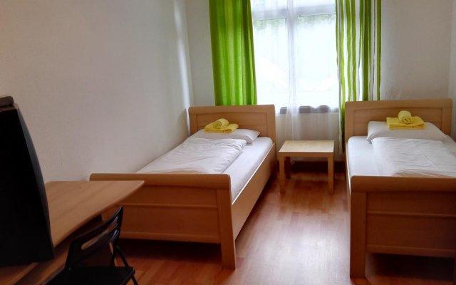 Отель Harsdörffer Apartment Германия, Нюрнберг - отзывы, цены и фото номеров - забронировать отель Harsdörffer Apartment онлайн комната для гостей