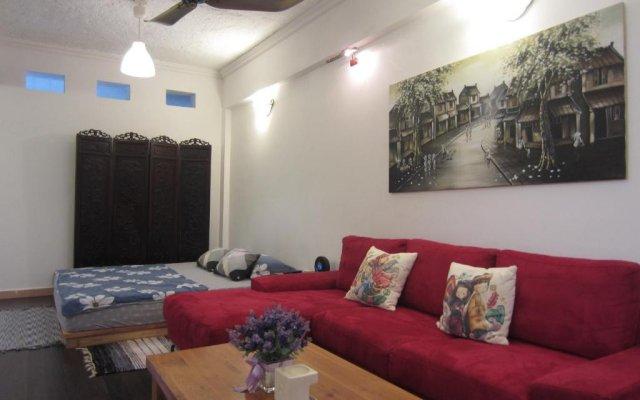Апартаменты Wind Chimes Studio комната для гостей