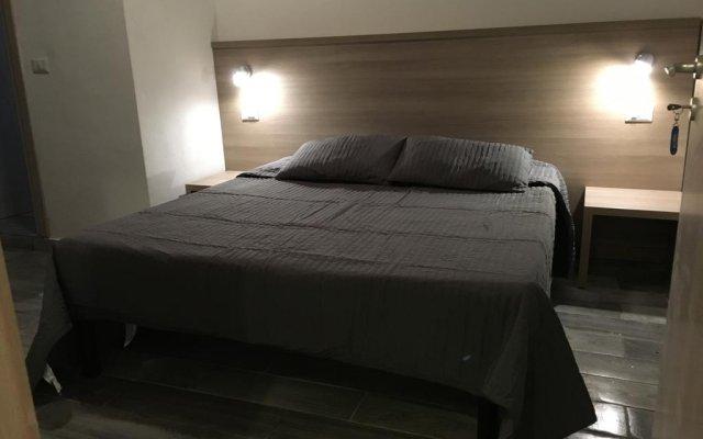 Отель Soperga Guest House Милан комната для гостей