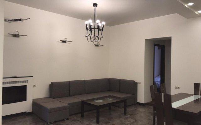 Отель Rent in Yerevan - Apartments on Sakharov Square Армения, Ереван - отзывы, цены и фото номеров - забронировать отель Rent in Yerevan - Apartments on Sakharov Square онлайн комната для гостей