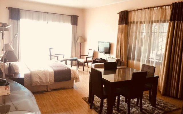 Отель L'Orchidee Hotel Республика Конго, Пойнт-Нуар - отзывы, цены и фото номеров - забронировать отель L'Orchidee Hotel онлайн комната для гостей