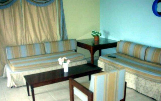 Отель Beach-side condos at Turtle Beach Towers комната для гостей
