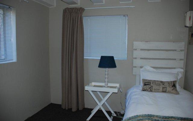 Отель Courtyard Lodging комната для гостей