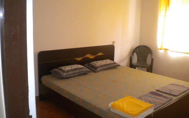 Апартаменты Lotus Benaulim - Beach Apartment Гоа комната для гостей