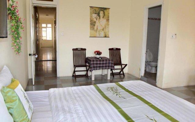 Отель Lucky House Hoi An комната для гостей