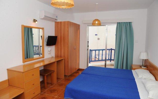 Alexia Hotel Apartments комната для гостей