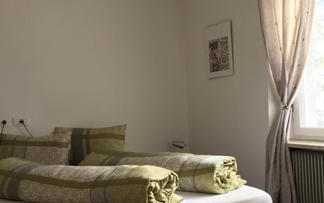Апартаменты City Apartments Portico Меран комната для гостей