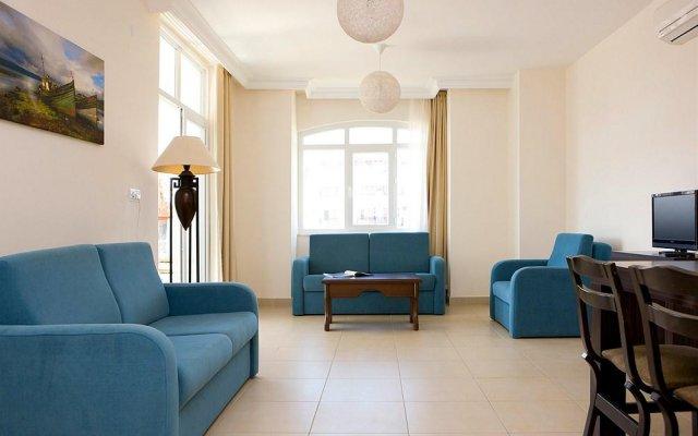 Апартаменты Irem Garden Apartments комната для гостей