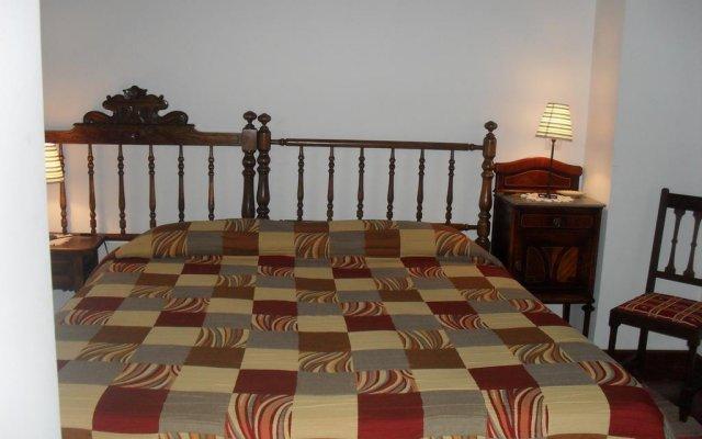 Отель Apartamentos Rurales la Taberna комната для гостей