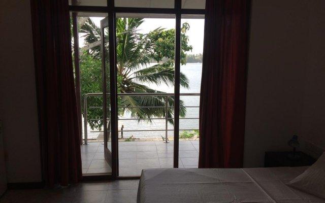 Отель Riverside Inn Fuji Шри-Ланка, Бентота - отзывы, цены и фото номеров - забронировать отель Riverside Inn Fuji онлайн комната для гостей