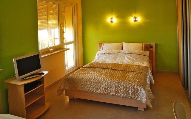 Отель Apartament Yasminum Вроцлав комната для гостей