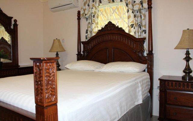 Отель Gorgeous Country Club Home Очо-Риос комната для гостей