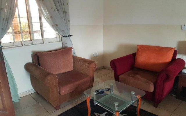 Отель Franphinas Suites & Hotels Нигерия, Калабар - отзывы, цены и фото номеров - забронировать отель Franphinas Suites & Hotels онлайн комната для гостей