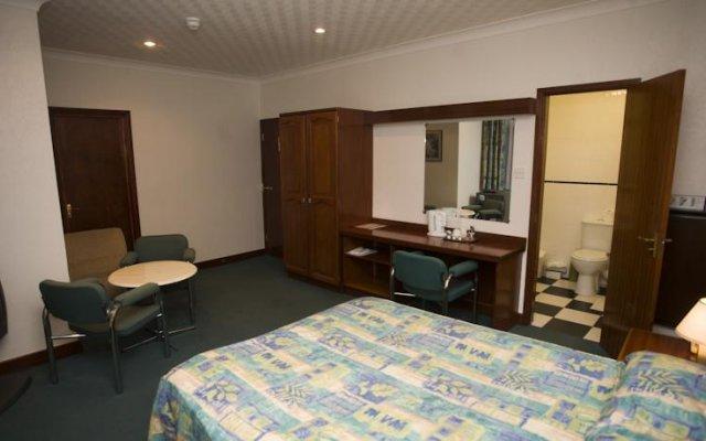 Отель Travelstop Inn комната для гостей