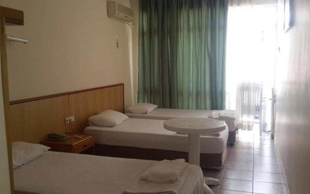 Güvenir Hotel комната для гостей