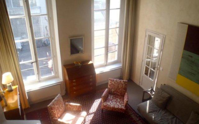 Отель Living in Paris - Saint Pères Франция, Париж - отзывы, цены и фото номеров - забронировать отель Living in Paris - Saint Pères онлайн комната для гостей
