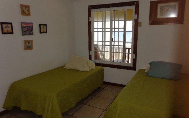 Отель Reef Point Beach House Гондурас, Остров Утила - отзывы, цены и фото номеров - забронировать отель Reef Point Beach House онлайн комната для гостей