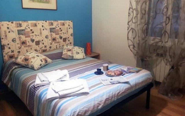 Отель Appartamento La Piazzetta комната для гостей