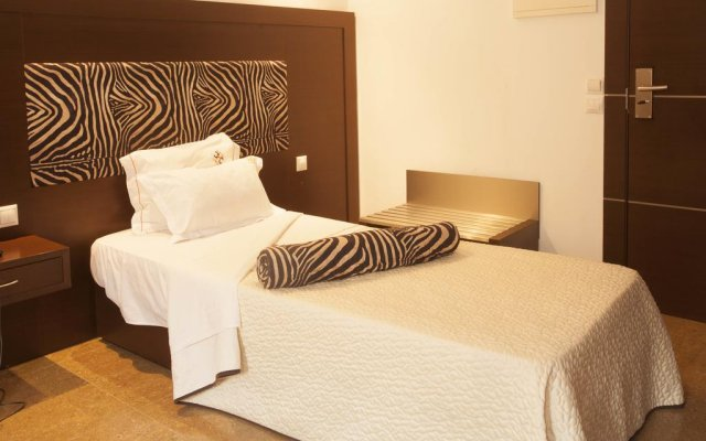 Chik-Chik Hotel Lobito I комната для гостей