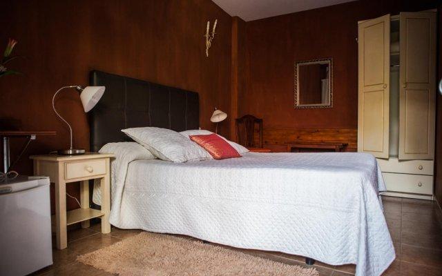 Отель La Asomada del Gato комната для гостей
