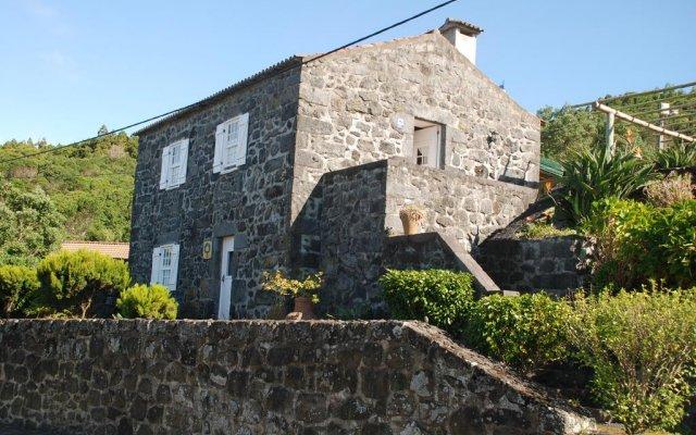 Отель Casas do Capelo вид на фасад