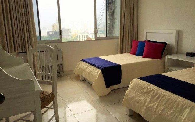 Отель Pent House Condo in Acapulco комната для гостей