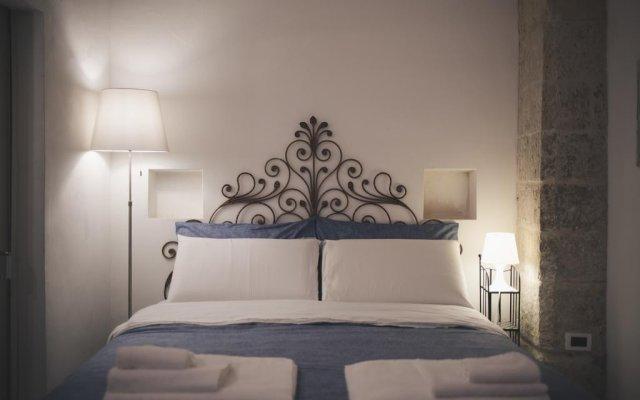 Апартаменты Apartment Don Giuliano Лечче комната для гостей