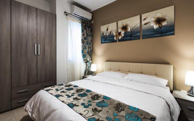 Отель Portside Lodge Марсаскала комната для гостей