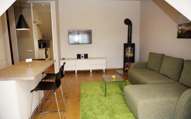 Апартаменты Milo Apartment комната для гостей
