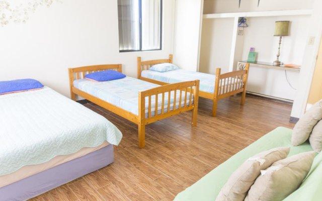 Отель Guam JAJA Guesthouse Тамунинг комната для гостей