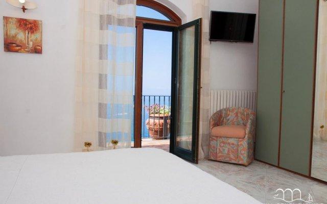 Отель Villa Conca Smeraldo Конка деи Марини комната для гостей