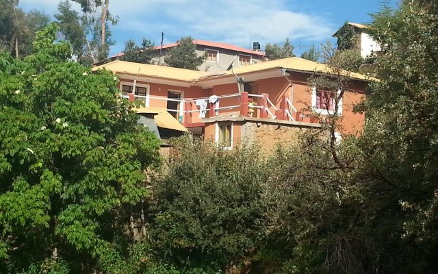 Отель Munay Lodge вид на фасад