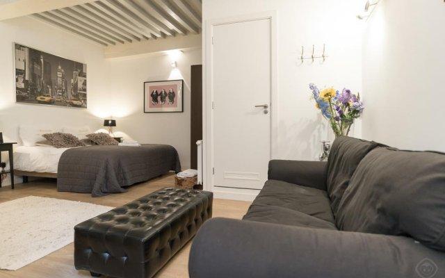 Отель Dam Square Suite комната для гостей