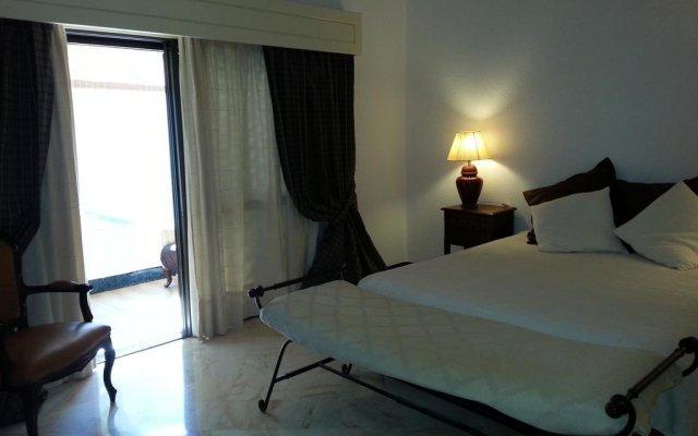 Отель Vilamoura Holidays Golf & Beach Португалия, Виламура - отзывы, цены и фото номеров - забронировать отель Vilamoura Holidays Golf & Beach онлайн комната для гостей