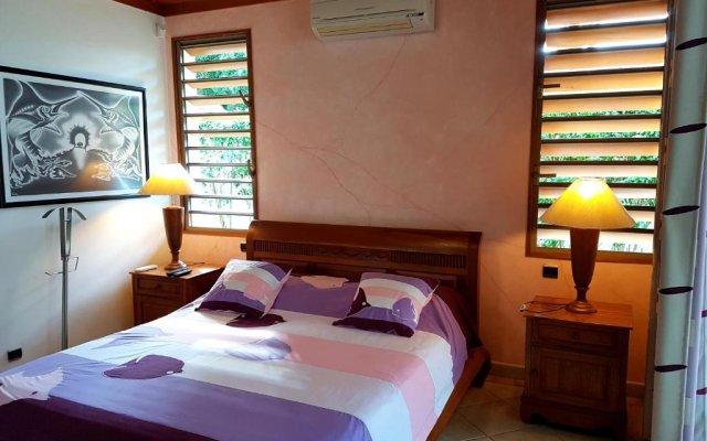 Отель Villa Oramarama by Tahiti Homes Французская Полинезия, Папеэте - отзывы, цены и фото номеров - забронировать отель Villa Oramarama by Tahiti Homes онлайн комната для гостей