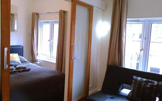 Отель Trafalgar Square Apartments Великобритания, Лондон - отзывы, цены и фото номеров - забронировать отель Trafalgar Square Apartments онлайн комната для гостей