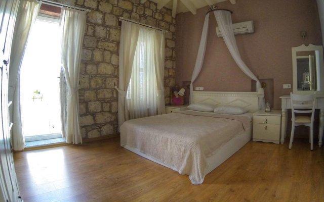 Отель Afet Hanım Taşev Чешме комната для гостей