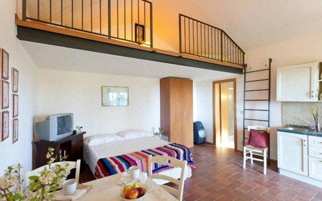 Отель Il Polveraio Agriturismo Lucia Монтескудаио комната для гостей