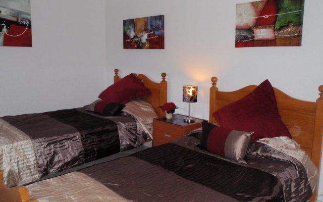 Отель Caroni Португалия, Виламура - отзывы, цены и фото номеров - забронировать отель Caroni онлайн комната для гостей