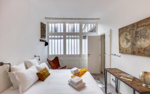 Апартаменты Sweet Inn Apartments - Rue De L'Echiquier комната для гостей